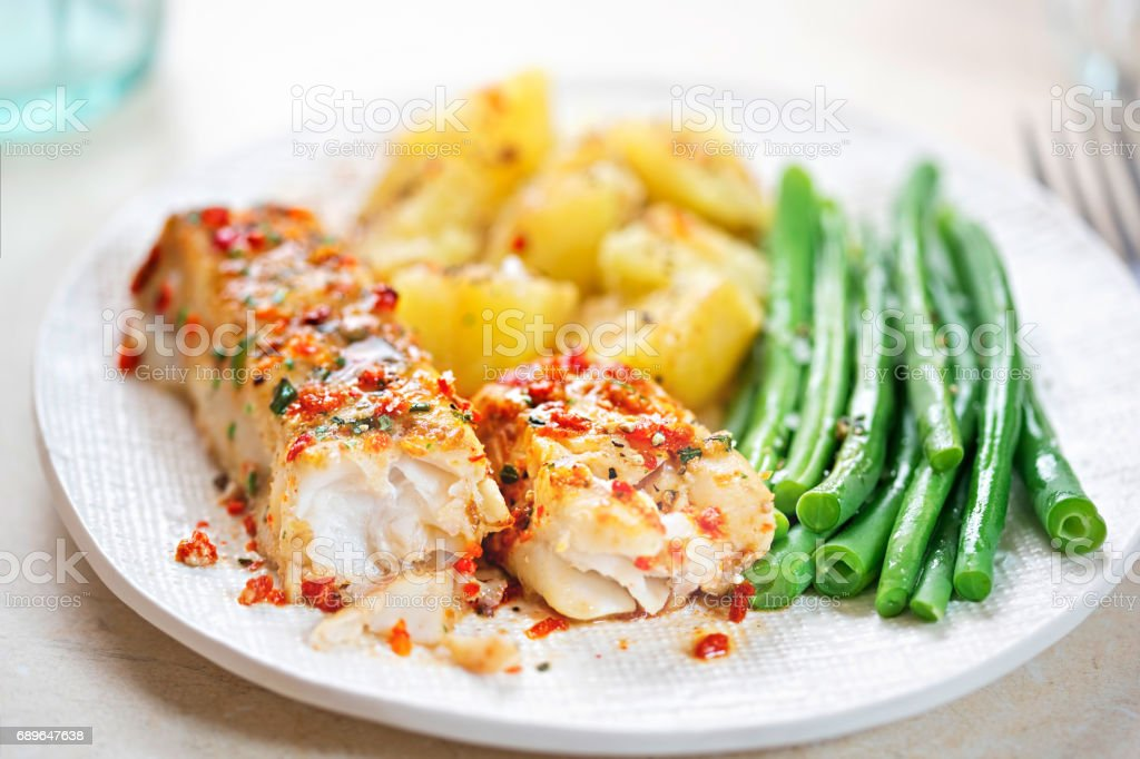 Tomato & basil chargrilled cod with green beans and potatoes stock photo