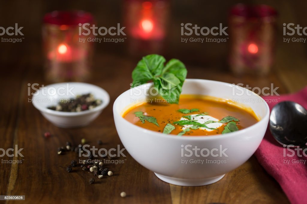 Tomato Bisque with Basil and Sour Cream Garnish stock photo