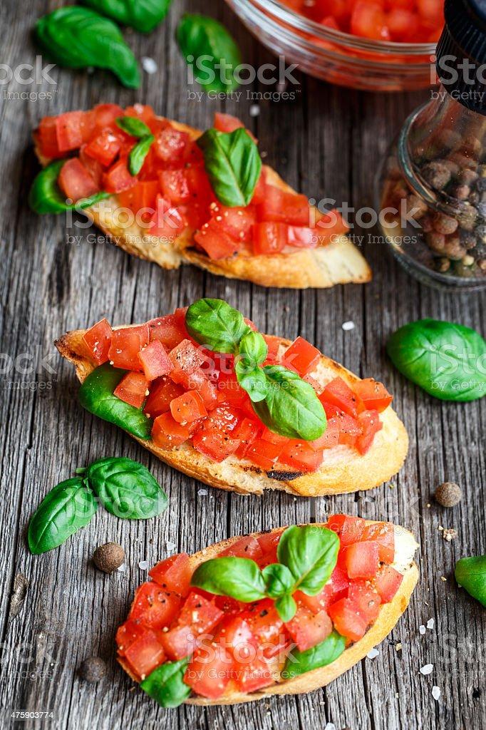 Tomato bruschetta with tomatoes and basil stock photo