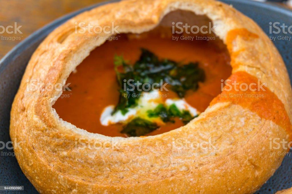 Tomato cream soup, soup puree served in round bread stock photo
