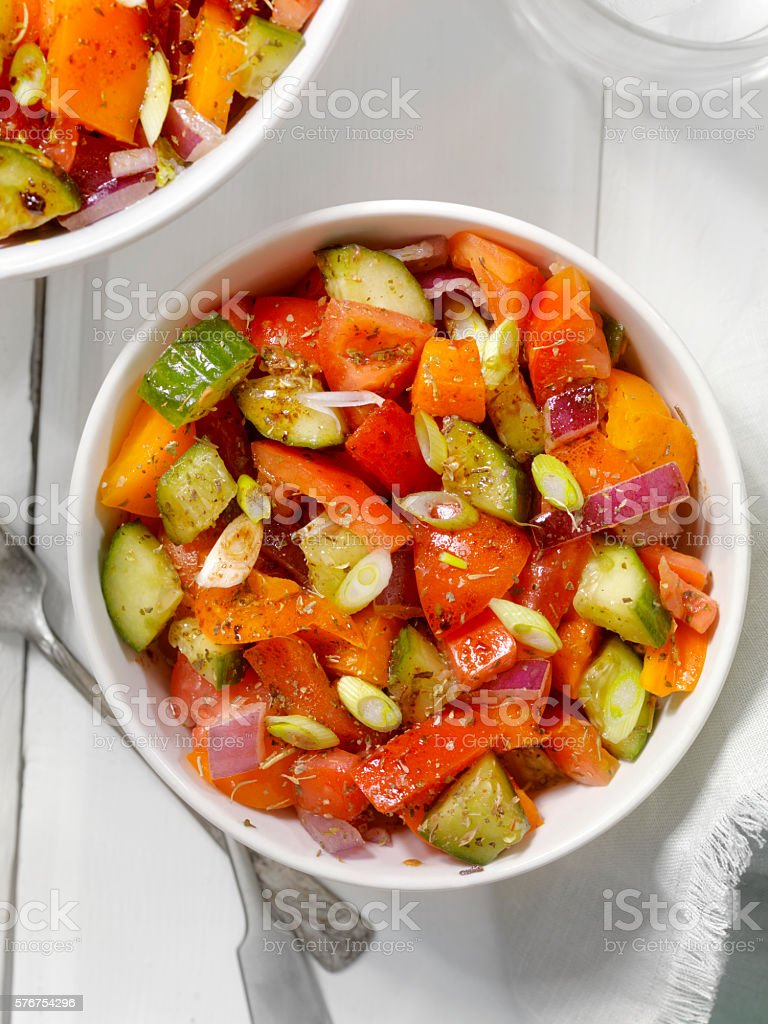 Tomato, Cucumber Salad with Oil and Vinegar Dressing stock photo