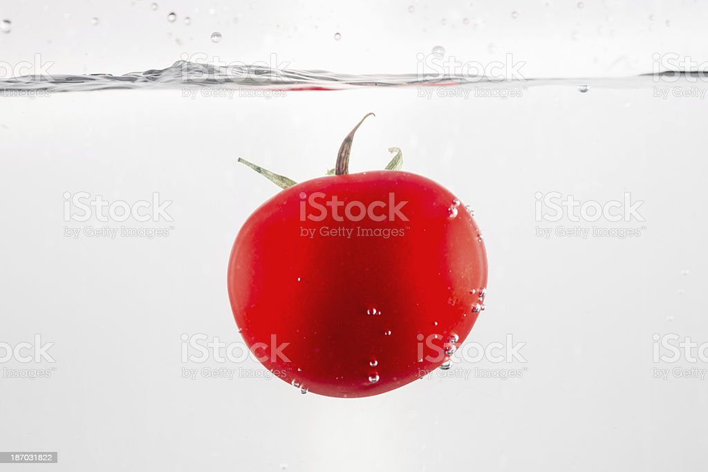 Tomato in water royalty-free stock photo