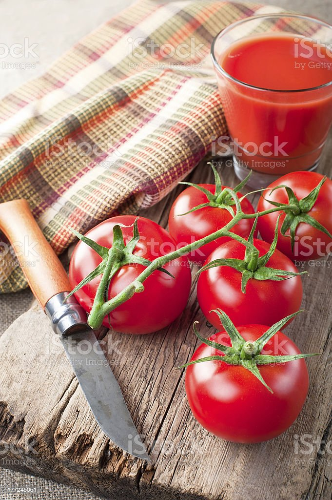 Tomato juice and  fresh tomatoes royalty-free stock photo