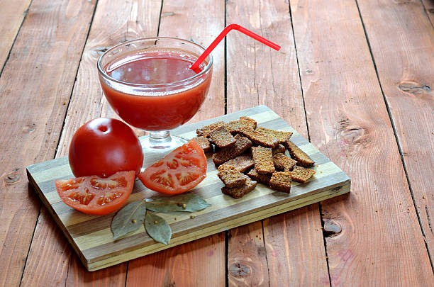 Tomato juice in glass and tomatoes, composition on table stock photo