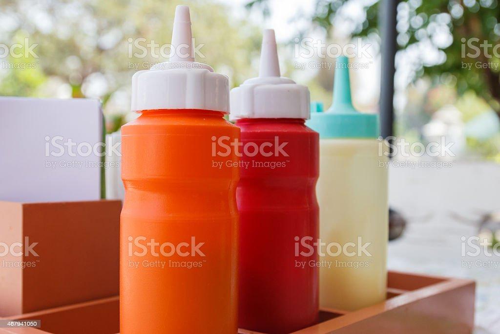 tomato ketchup, chili sauce and mayonnaise stock photo