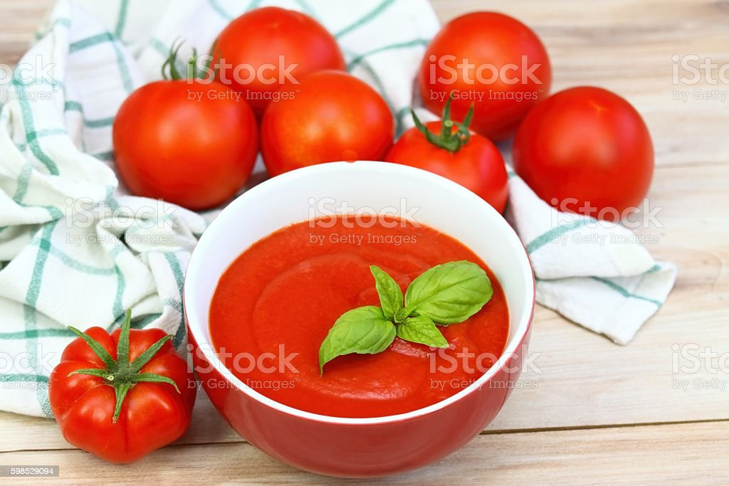 Tomato ketchup in red bowl stock photo