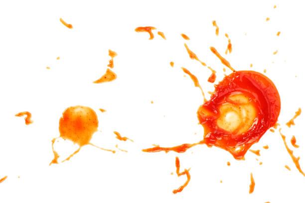 tomato ketchup splashes on white background. top view. - sauce tomatoes imagens e fotografias de stock