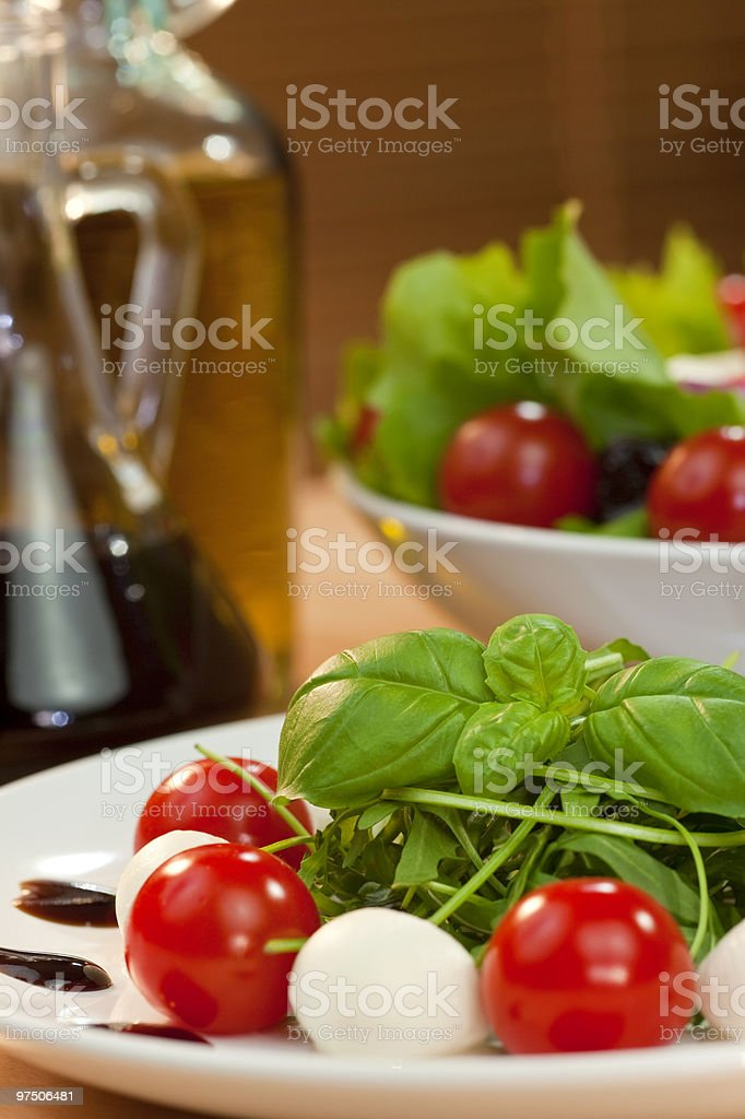 Tomato Mozzarella Rocket Salad With Olive Oil and Balsamic Vinegar royalty-free stock photo