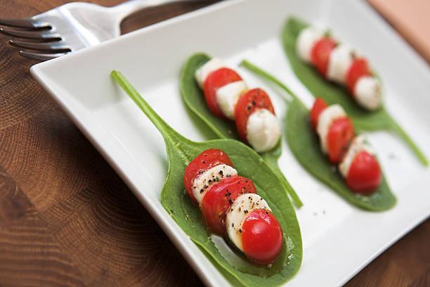 Tomato, mozzarella & spinach salad stock photo