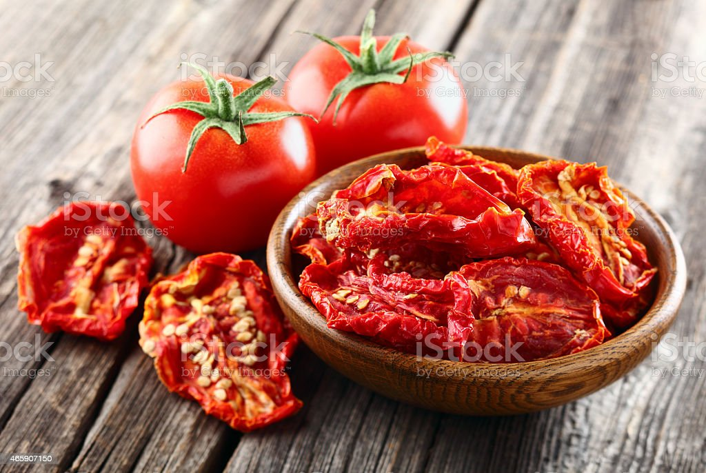 Tomato on a wooden background stock photo