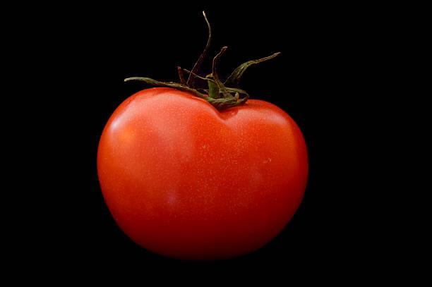 Tomato on Black stock photo