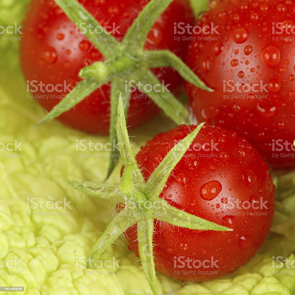 Tomato on green leaf of salad royalty-free stock photo