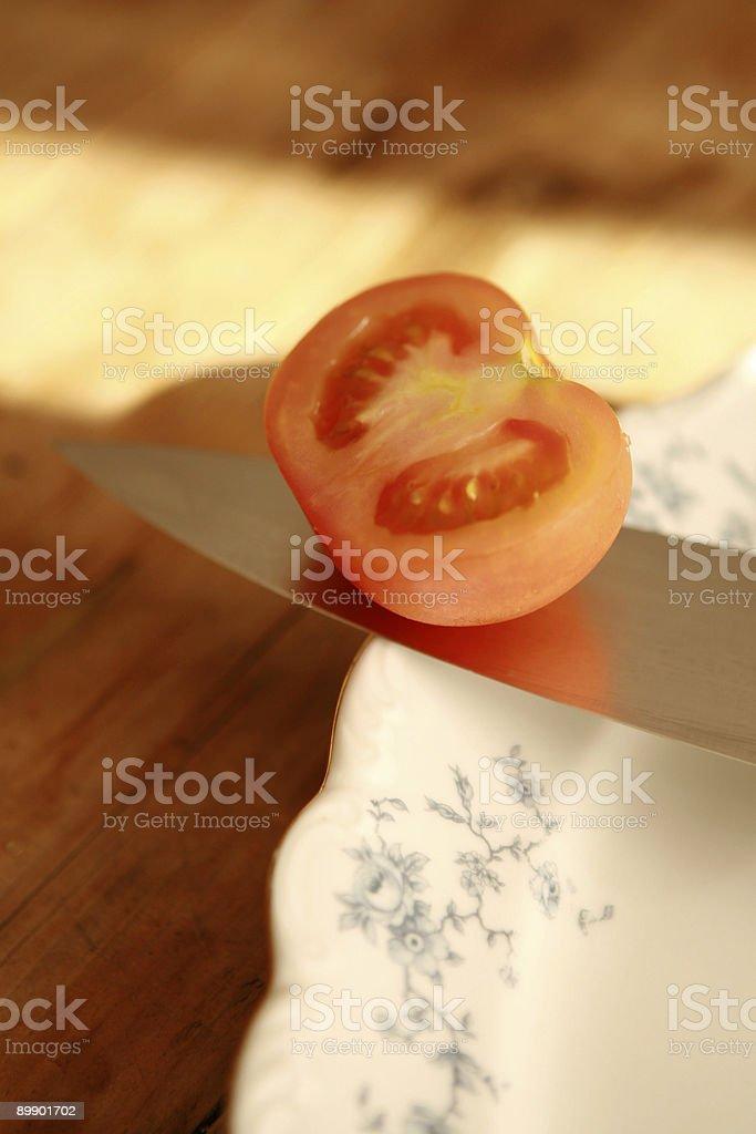 Tomato on Knife royalty free stockfoto