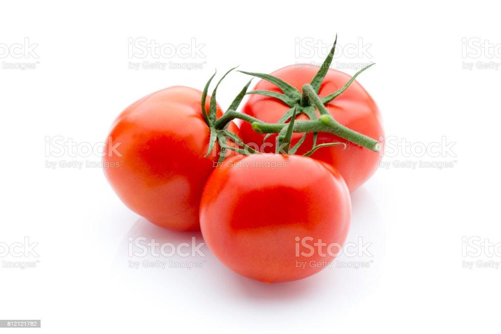 Tomato on the white isolatd background. stock photo