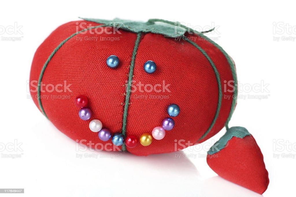 tomato pin cushion stock photo