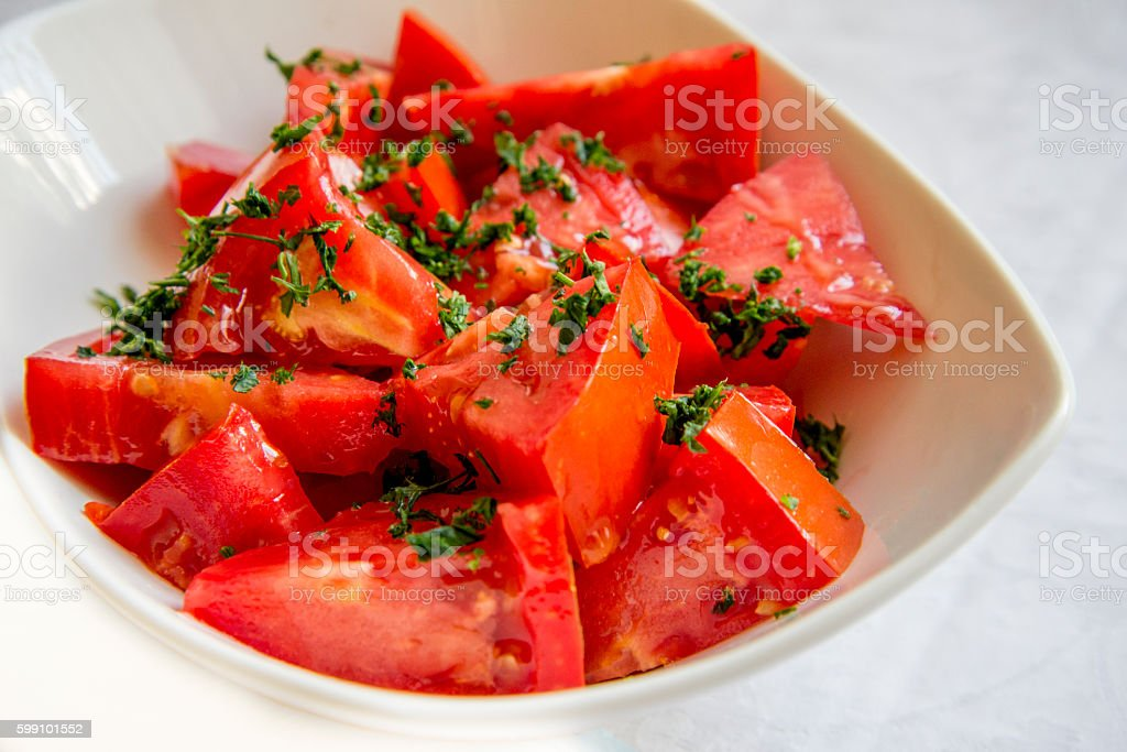 Tomato salad in a bowl stock photo