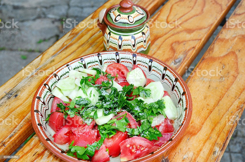 Tomato salad in traditional bulgarian plate stock photo