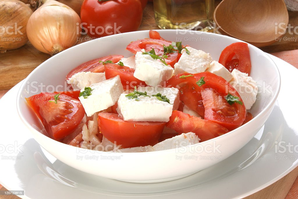 Tomato salad with feta cheese and parsley stock photo