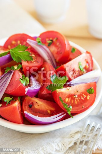 Tomato salad with onion, parsley and black pepper in bowl - healthy vegetarian vegan diet organic food appetizer