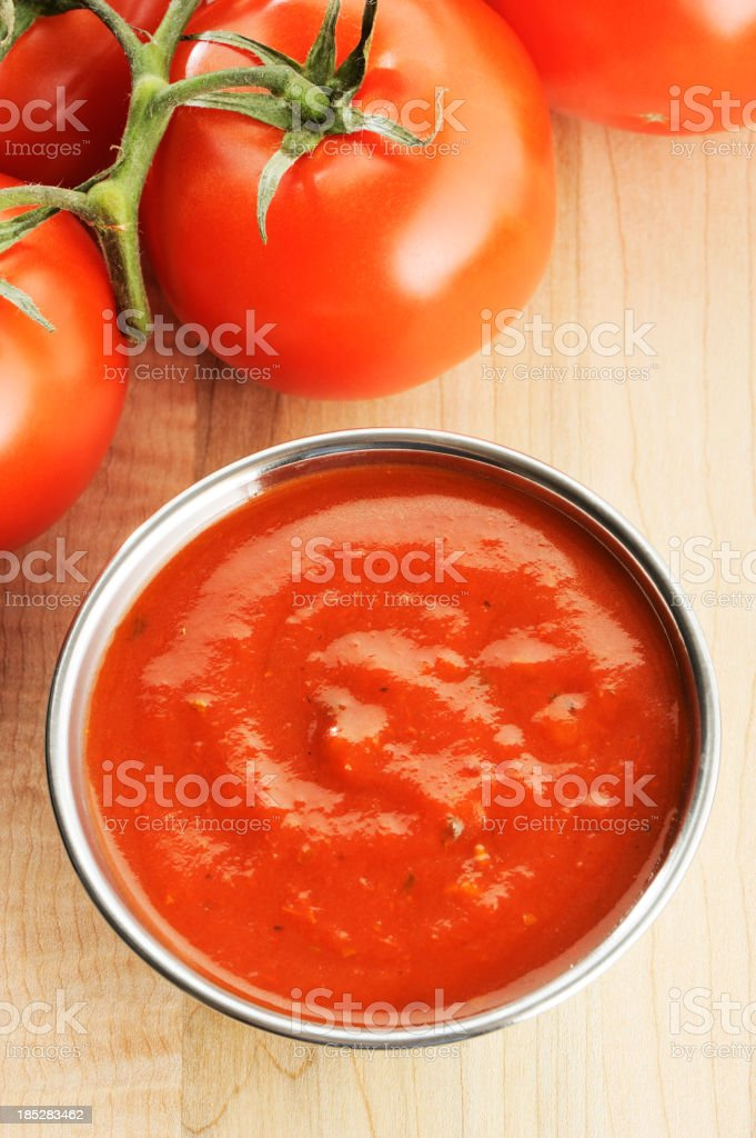 Tomato sauce in bowl with tomatoes stock photo