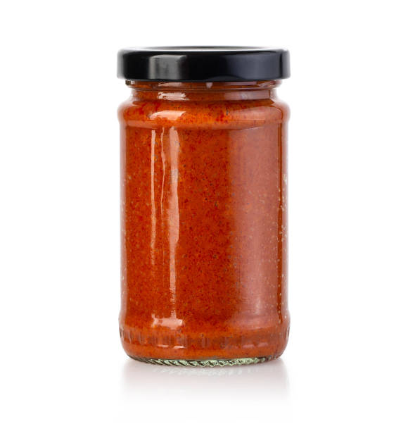 Tomato sauce jar on white background Tomato sauce jar on white background with clipping path sauce stock pictures, royalty-free photos & images