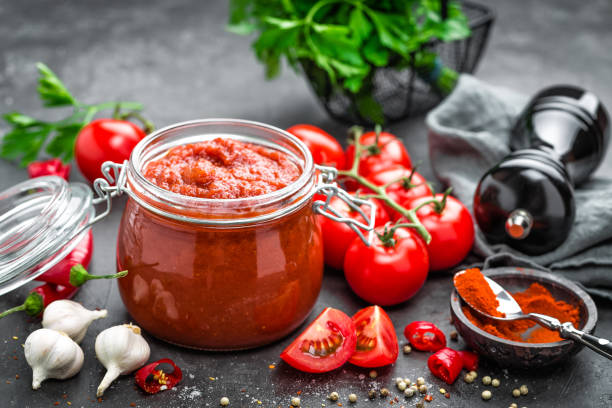 tomato sauce - tomato can stock photos and pictures