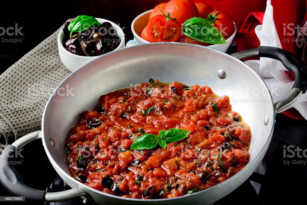 Tomato Sauce with basil and olives stock photo