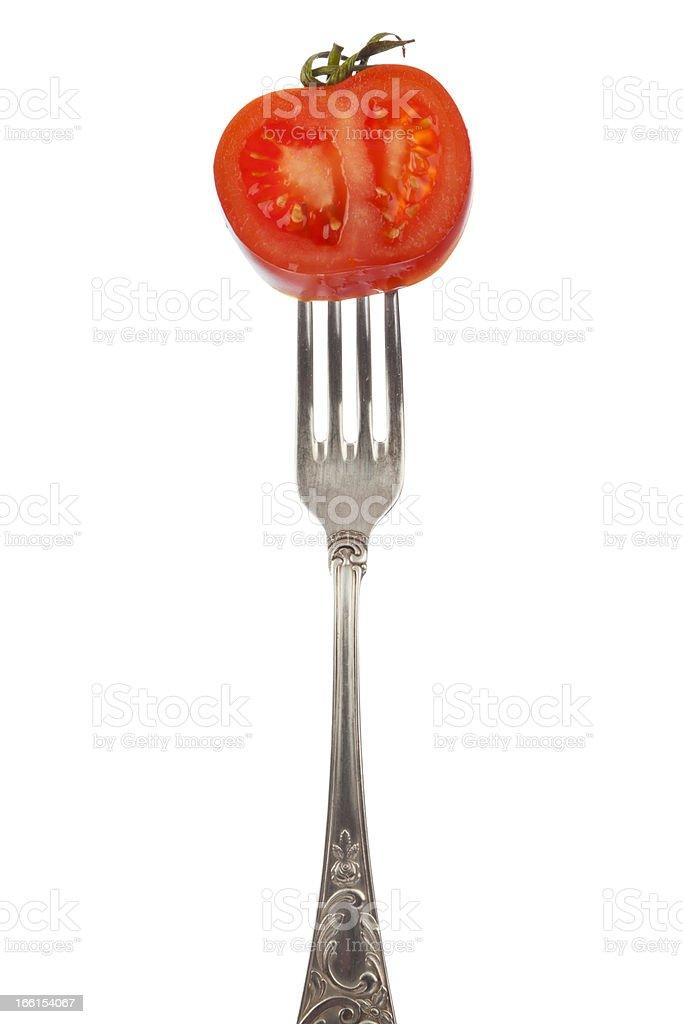 Tomato slice on silver fork royalty-free stock photo
