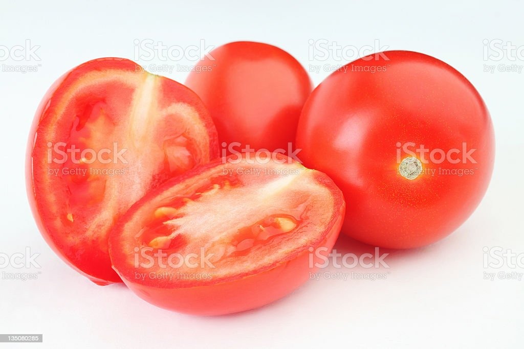 Tomato. Sliced group of red tomatoes stock photo