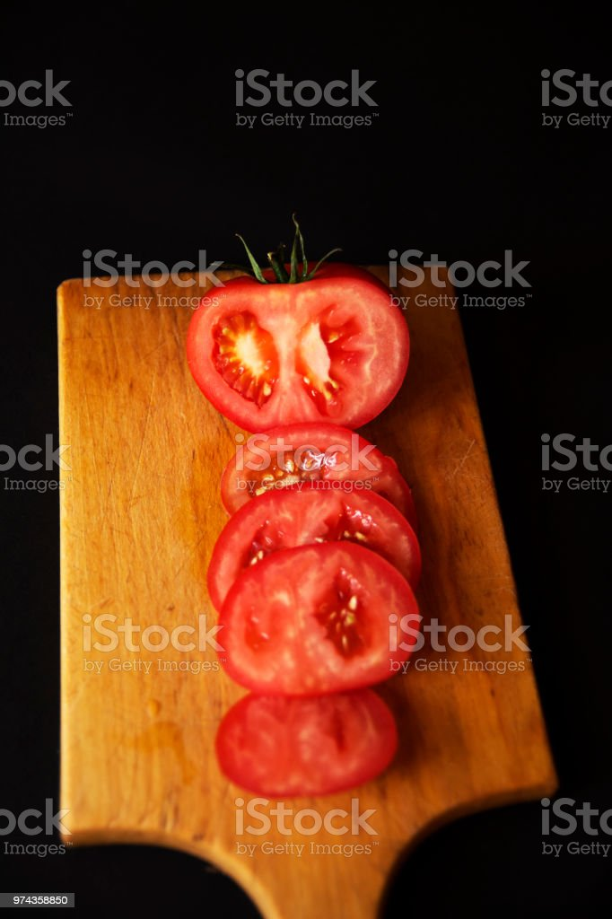 Tomato sliced on cooking board stock photo
