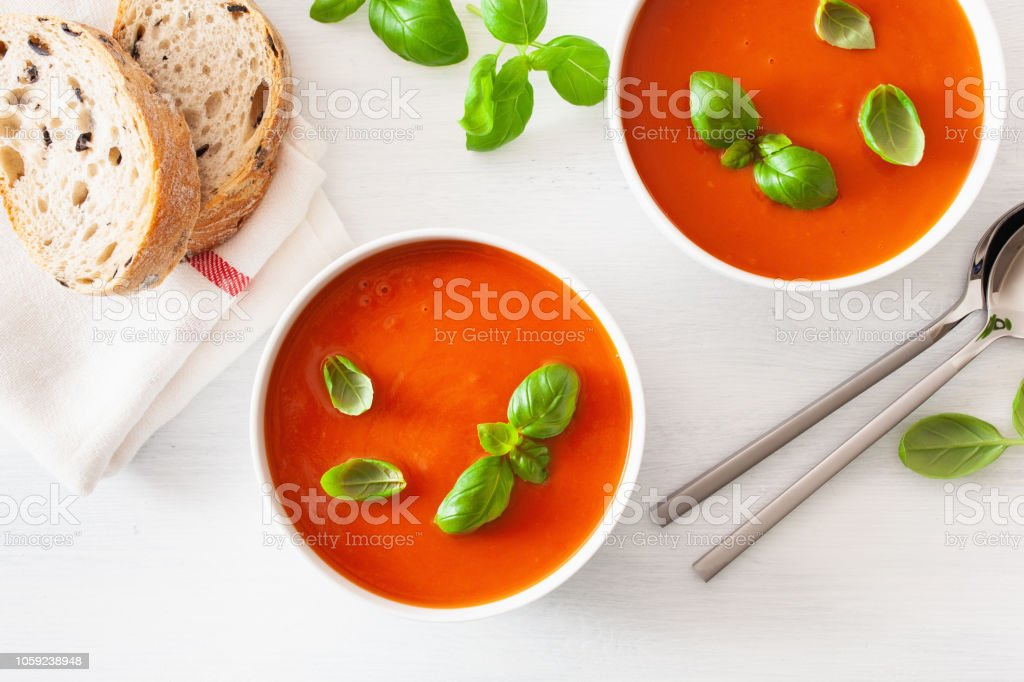 tomato soup flat lay on white backgorund stock photo