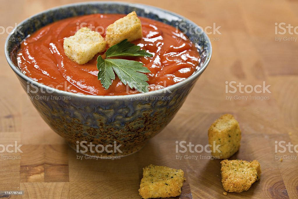 Tomato Soup In A Blue Ceramic Bowl royalty-free stock photo