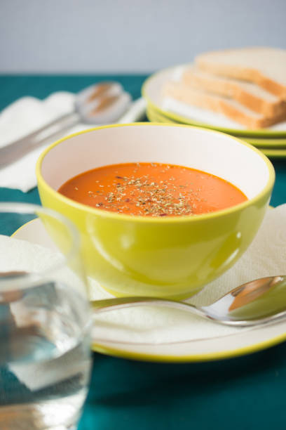 tomato soup in a bowl stock photo