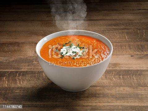 Tomato Soup with cheese and fresh mint leaves.