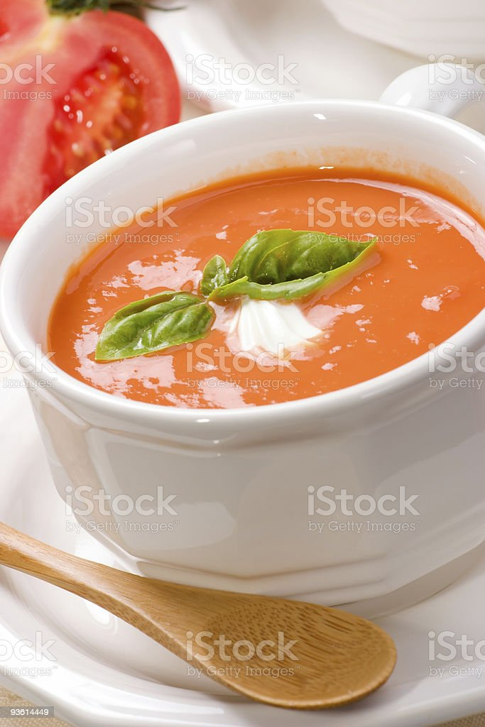 Tomato soup served on white bowl stock photo
