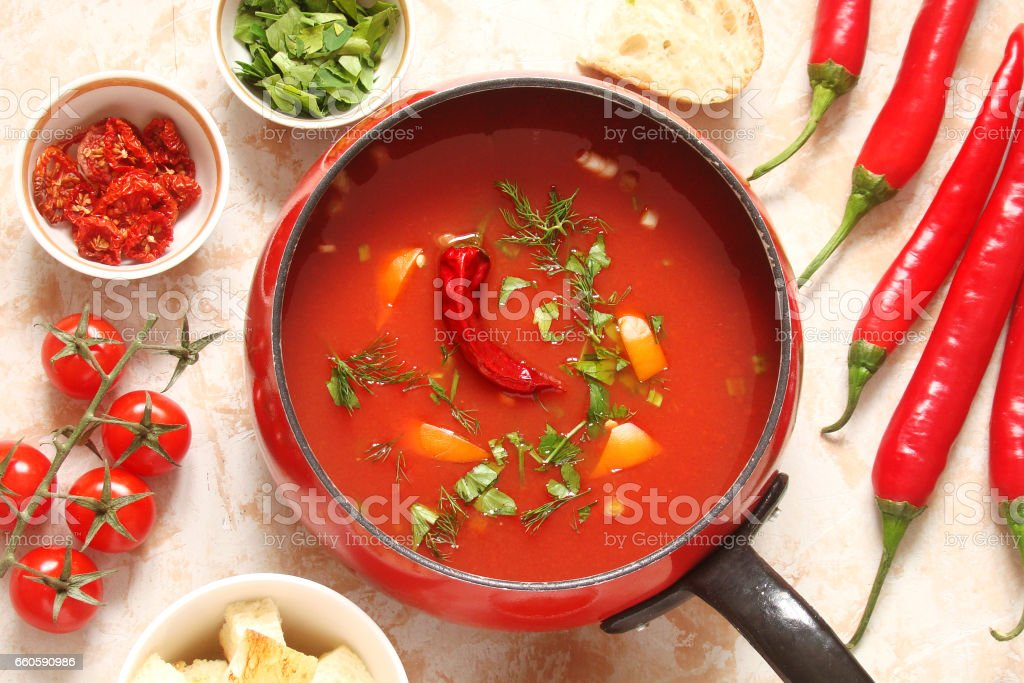 tomato soup with chilli peppers, sweet peppers, garlic, herbs and spices with toast royalty-free stock photo