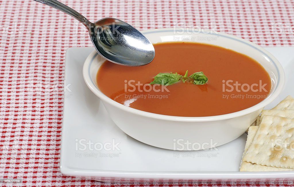 tomato soup with crackers and basil royalty-free stock photo