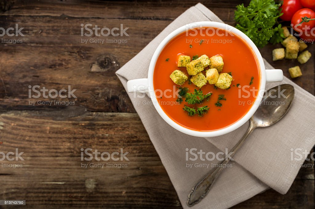 Tomato soup with croutons stock photo