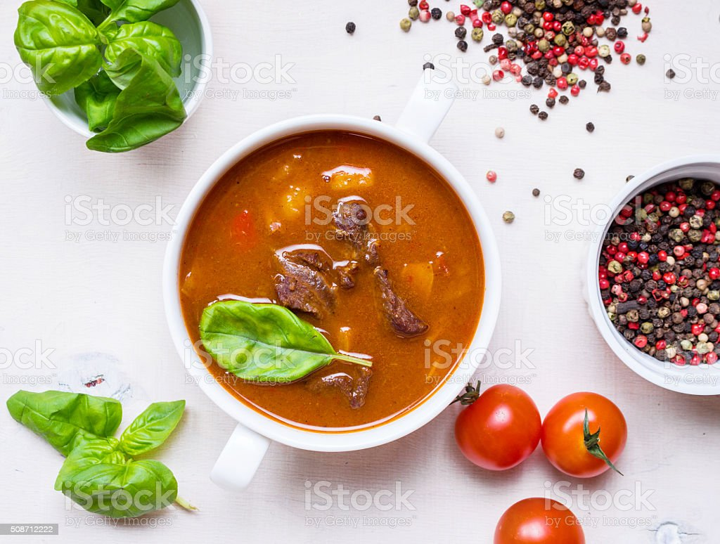 Tomato soup with meat in a white bowl stock photo