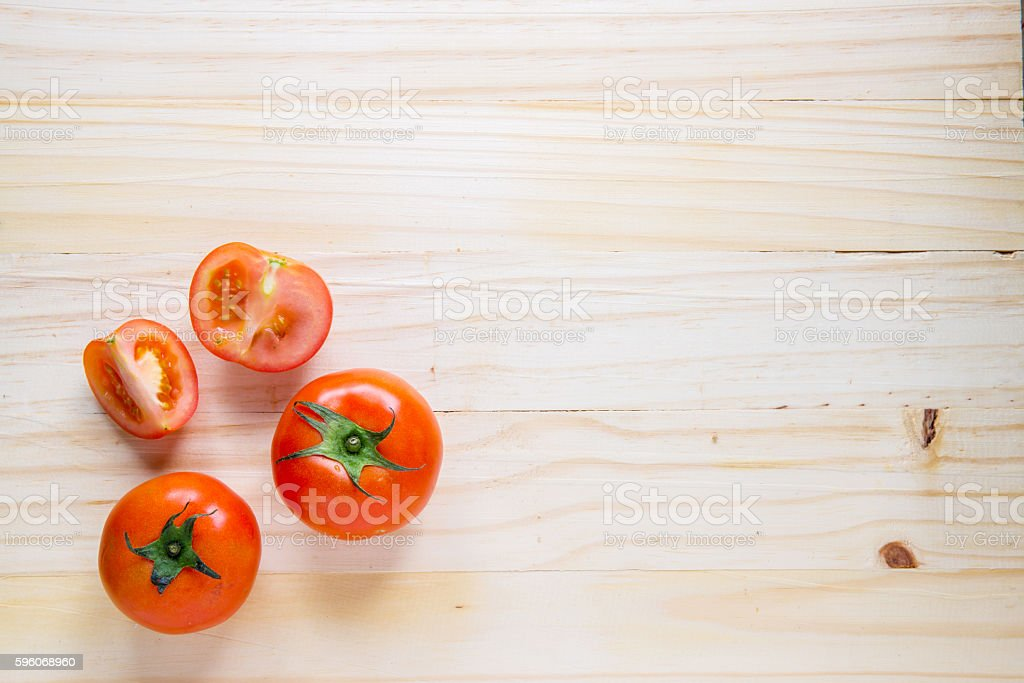 tomato, top view on wood background royalty-free stock photo