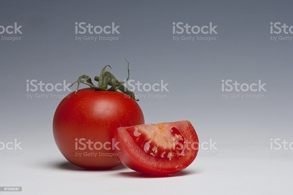 Tomato whole and sliced royalty-free stock photo