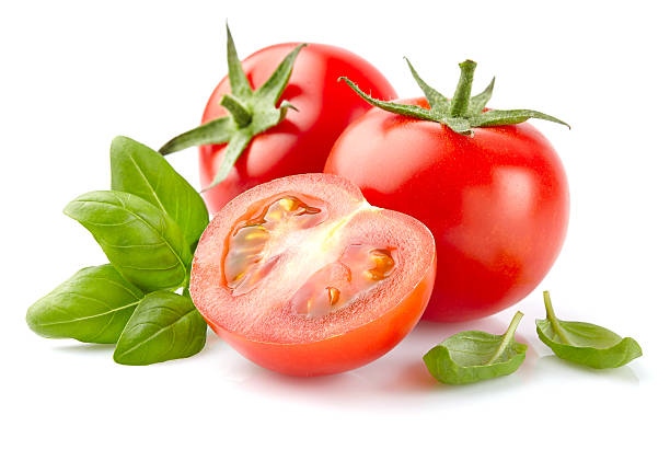 tomato with basil - basil stock photos and pictures