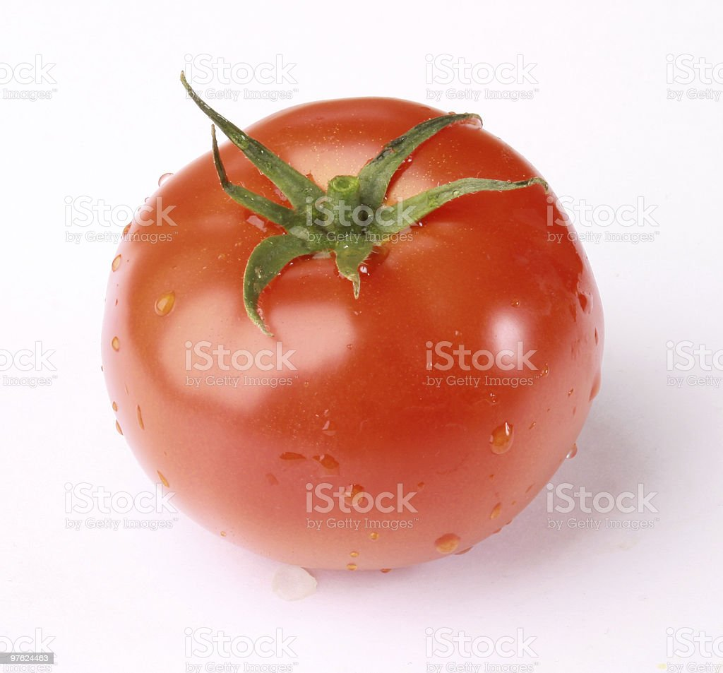 Tomato with drops royaltyfri bildbanksbilder