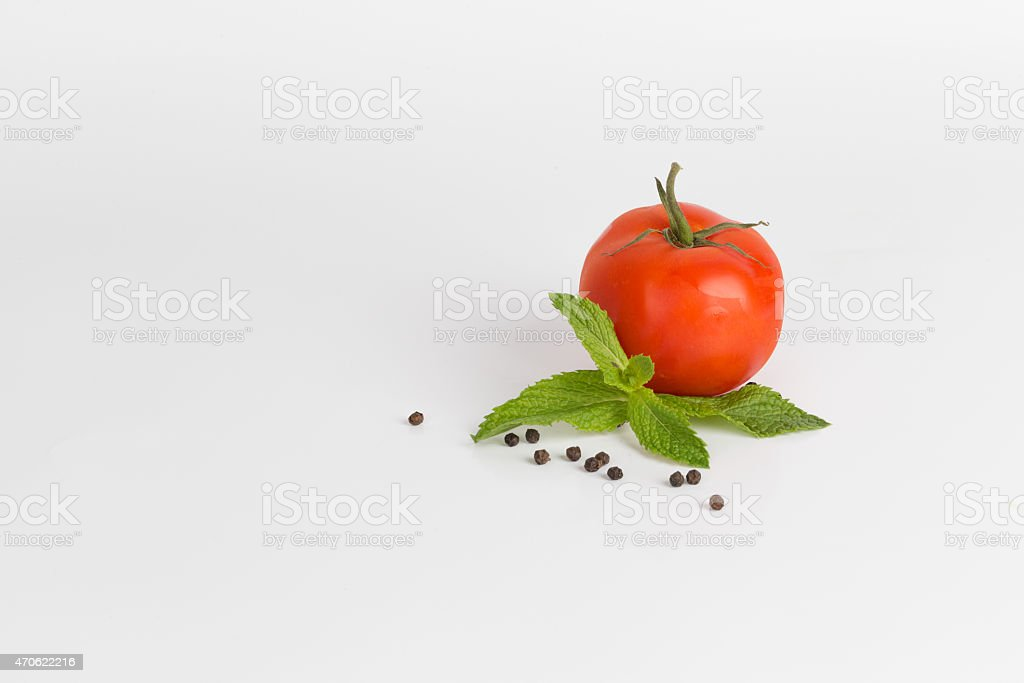 Tomato with fresh Mint leaves and peppercorns stock photo