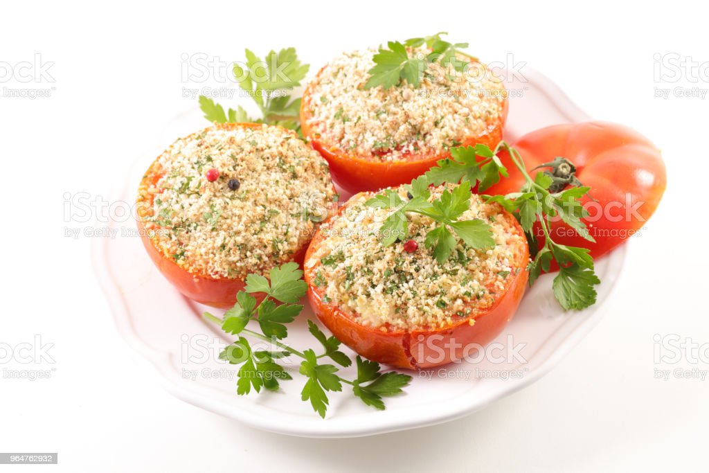 tomato with garlic and herbs royalty-free stock photo