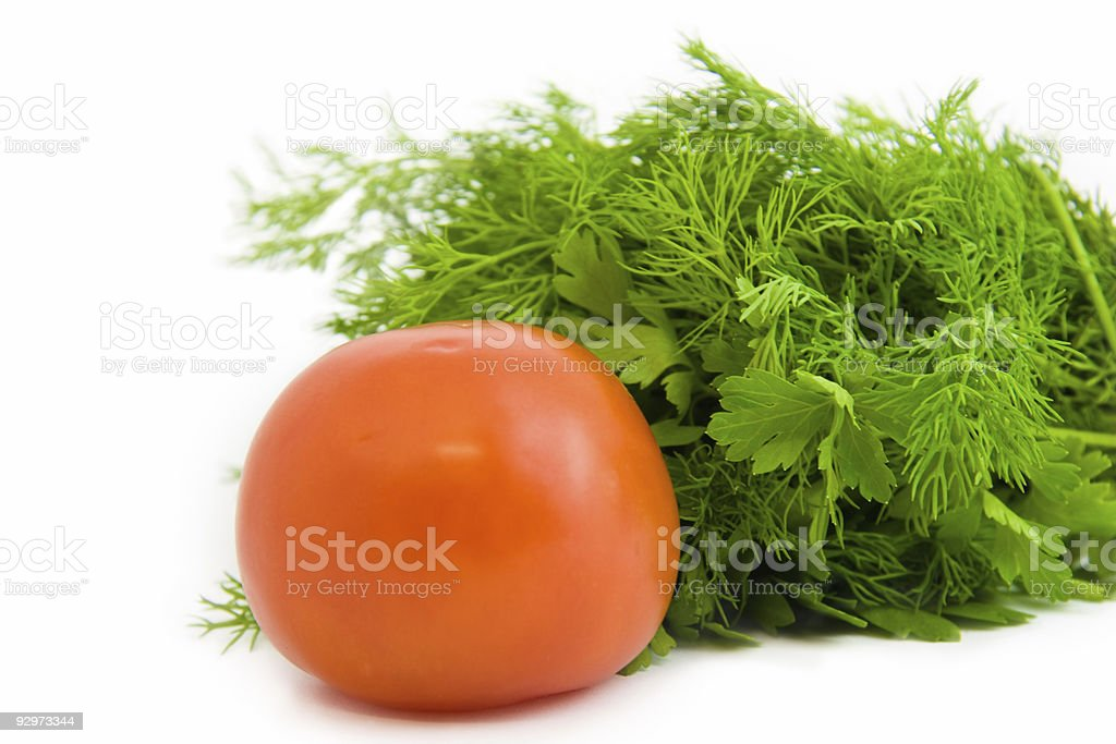 Tomato with parsley royalty-free stock photo
