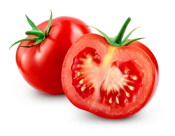 Tomato with slice isolated. With clipping path. stock photo