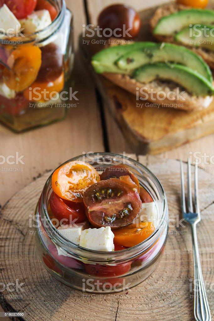 Tomatoe salad and avocado toast stock photo