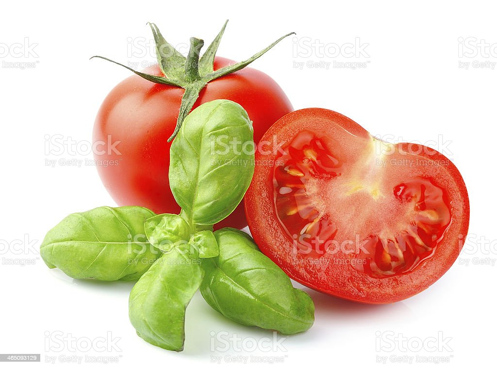 Tomatoes and basil leaves stock photo