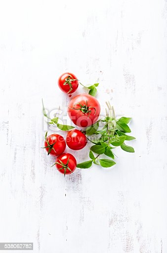 Tomatoes and Basil on a Wooden Background